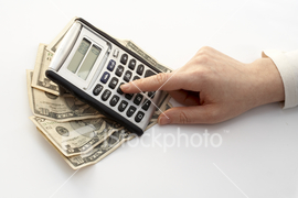 calculating_over_a_fan_of_money.jpg
